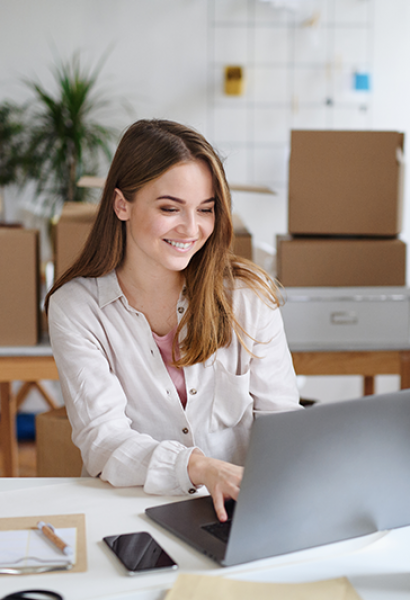 young-woman-dropshipper-with-laptop-working-at-hom-WEVGR76.png